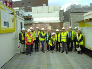 Members of Red Velvet Cinema on a 'school trip' to the construction site of the new £37 million pound history centre in Plymouth (Caroline Blackler is fifth from the left).